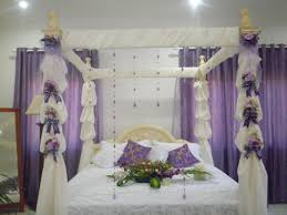 beautiful bridal bedroom decor with white bedding and purple