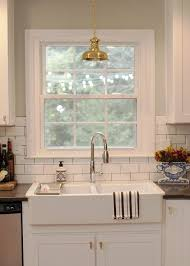 double pendant lights over sink traditional kitchen ikea domsjo double bowl traditional kitchen the every girl