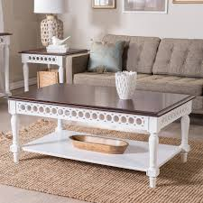 small bookshelf ideas living room rectangle cottage carved wood off white coffee table