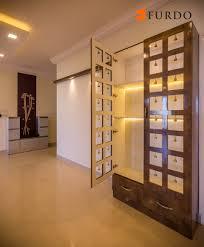 graceful puja unit mandir with hanging bells by furdo interiors