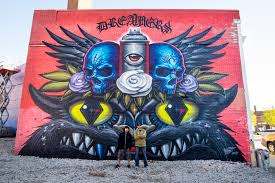murals in the market artists address shepard fairey detroit and click to enlarge los angeles based artists jeff soto and maxx242 stand in front of their finished mural