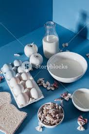 bottle and bowls of milk biscuits apples slices of bread eggs