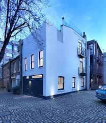threefold architects updates london mews house with monochrome