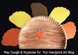 paper plate turkey craft with footprint feathers