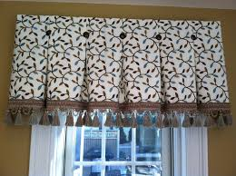 inverted box pleat valance tacked with bronze nail heads at each
