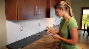 How To Install A Tile Backsplash In Kitchen by Metal Backsplash Tile Installation Youtube