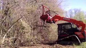 zimmer tractor demos a kubota svl 90 with a fecon youtube