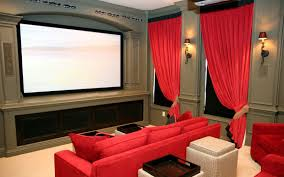 home theatre with luxury design with red chairs and artistic