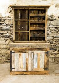 saloon style rustic wine rack and liquor cabinet by