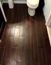 wood tile bathroom ideas and tips for exquisite modern bathroom dark brown subway wood tile bathroom flooring installation also white closet and pedestal sink in half bathroom