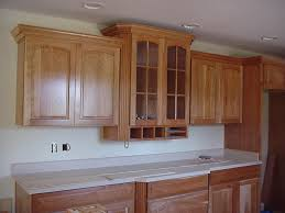 How To Mount Kitchen Wall Cabinets Admirable White Wooden Color Crown Molding For Cabinets Features