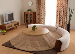 small japanese heated table with a blanket for winter living room