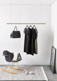 interior design idea coat racks that hang from the ceiling