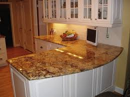 white wooden kitchen cabinet and brown granite countertops