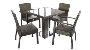 dining room dark grey with armset and square table glasses wicker