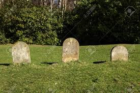 grave stones three small blank grave stones in a line stock photo picture and