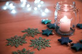 photo of burning christmas candle in a glass jar free christmas