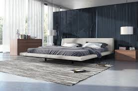 bedroom white alaskan king bed with black wood wall us white