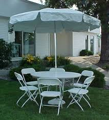 umbrella table and chairs table umbrella and chairs herriott sherriott s
