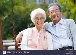 Old Man In Rocking Chair Happy Old Couple Sitting In The Rocking Chair Stock Photo Royalty