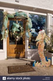 entrance to gift shop decorated with a christmas nautical theme in
