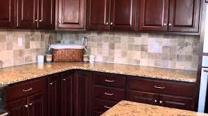furniture dark starmark cabinets with merola tile backsplash and
