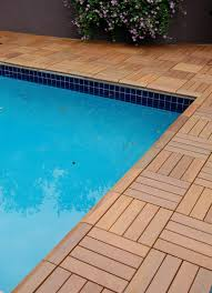 swiftdeck wood patio tiles right to the pool edge some novel