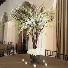 manzanita tree centerpiece manzanita tree centerpieces terra flowers miami wedding