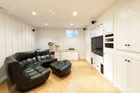 finished basement of residential home with entertainment center