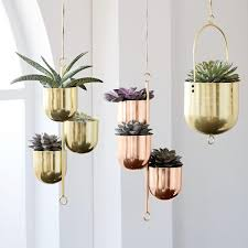 hanging metal planters in gold and copper love these house