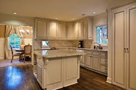 antique white kitchen cabinets with chocolate glaze modern chairs
