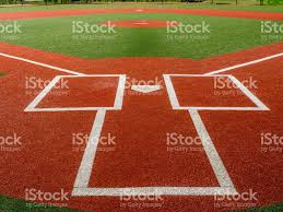 artificial turf baseball field from behind home plate stock photo