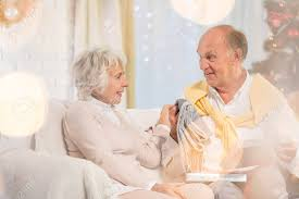 what to get an elderly woman for christmas elderly woman and senior opening his christmas gift box stock