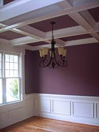 coffered ceiling and wainscoting with a purple wall and ceiling