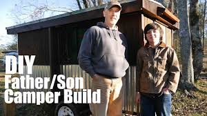 father and son project low cost diy camper at tiny house