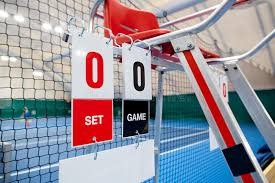 umpire chair with scoreboard on a tennis court before the game stock image