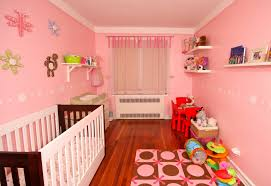 Unique Nursery Decorating Ideas Baby Room With Simple Cradler On Wooden Flooring With