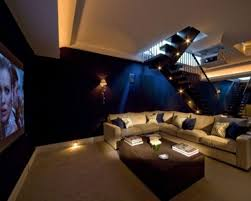 Chic Home Theater Design With Cozy Couch Front Flowers Brown