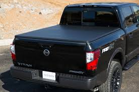 nissan frontier truck bed cover nissan showcases accessories for new titan xd at chicago