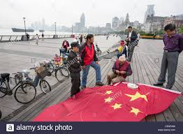 Chineses Flag Flying Chinese Flag Kite In Early Morning On The Bund In Shanghai