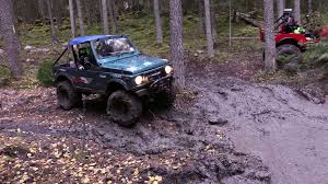 muddy jeep offroad driving different cars on a very muddy road in the forest