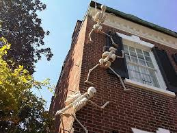 homes decorated for halloween skeleton halloween decorations climbing up a house google search