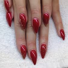 red stiletto nails with gold glitter pictures photos and images