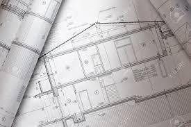 house plan blueprints roled up over table stock photo picture and