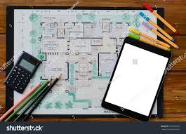 floor plan area calculator blank screen tablet computer calculator drawing stock photo