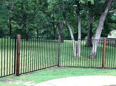 two rail pressed spear ornamental iron installed by titan fence