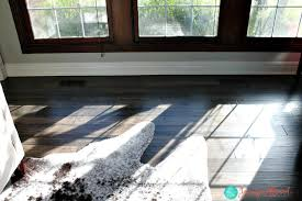 paint your ugly floor vents to blend in to your wood floor