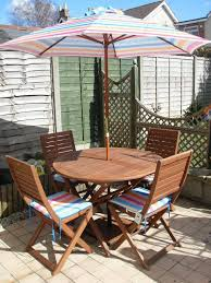 Patio Furniture Set With Umbrella by Peru 4 Seater Wooden Garden Furniture Set With Folding Chairs