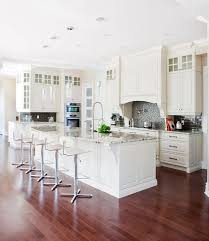 44 kitchens with double wall ovens photo examples gorgeous white kitchen with double stainless steel wall ovens tucked in the corner of the kitchen