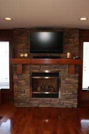 interior brick stone fireplace on laminate flooring between